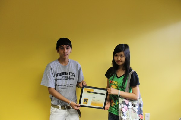 Puspa and Gaywah hold Sagal Radio's award for hosting the IRC interns